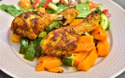 Kycklingben med pumpa och zucchini i ugnen